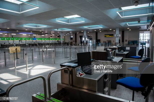 Empty check in desks inside the currently closed North Terminal at Gatwick Airport on June 9, 2020 in London, England. Gatwick Airport has introduced...