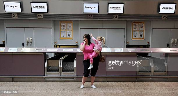 Empty CheckIn counters are pictured at Glasgow airport in Scotland on April 15 after the airport was closed following a cloud of volcanic ash from an...