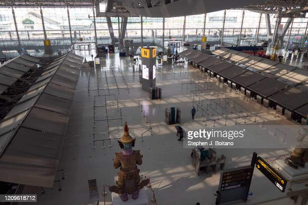 Empty check-in counters at Suvarnabhumi Airport after the Bangkok government ordered most flights grounded due to the rapid spread if the Covid-19...