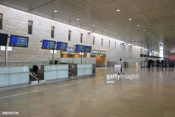 empty check-in counters in tel aviv international airport, israel - striker stock pictures, royalty-free photos & images
