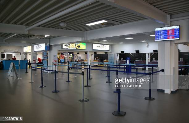 Empty checkin desks are pictured inside Exeter Airport in Exeter southwest England on March 5 following the news that the airline Flybe had collapsed...
