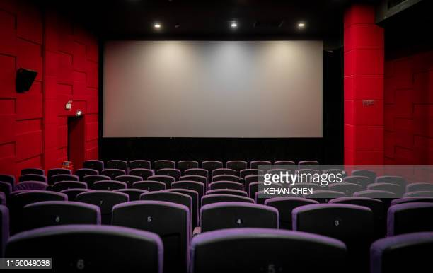 empty cinema with empty seats - projection screen stock pictures, royalty-free photos & images