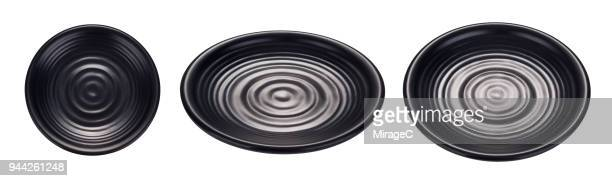 empty circle black plate on white - oval shaped objects stock pictures, royalty-free photos & images