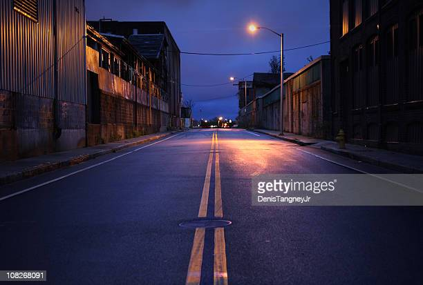 empty city street at dusk - double yellow line stock photos and pictures