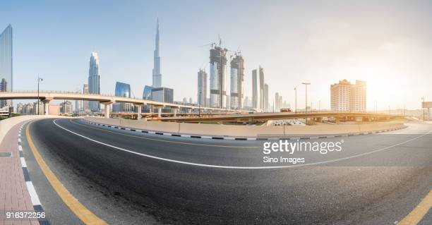 empty city street at sunset, dubai - image stock pictures, royalty-free photos & images