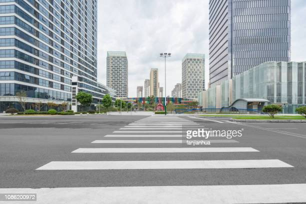 empty city street,crossroad - crossroad stock pictures, royalty-free photos & images
