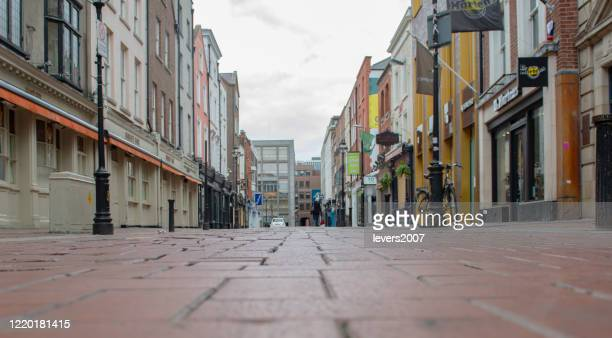 empty city streets during covid 19, dublin, ireland. - leinster province stock pictures, royalty-free photos & images