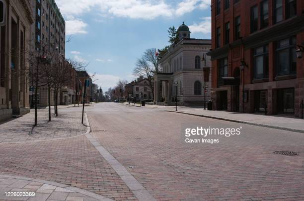 empty city streets in kingston, ontario during covid 19 pandemic. - canada stock pictures, royalty-free photos & images