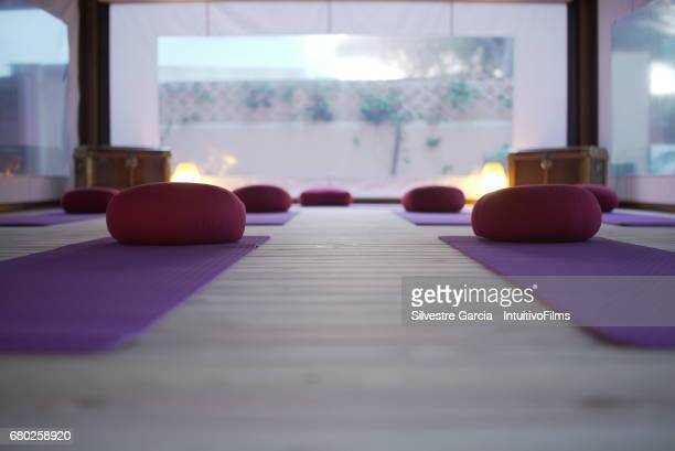 A empty class of yoga at sunset.