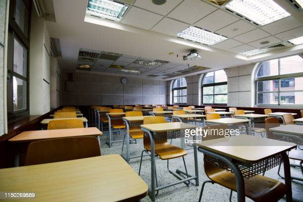empty classroom or lecture hall - lecture hall stock pictures, royalty-free photos & images