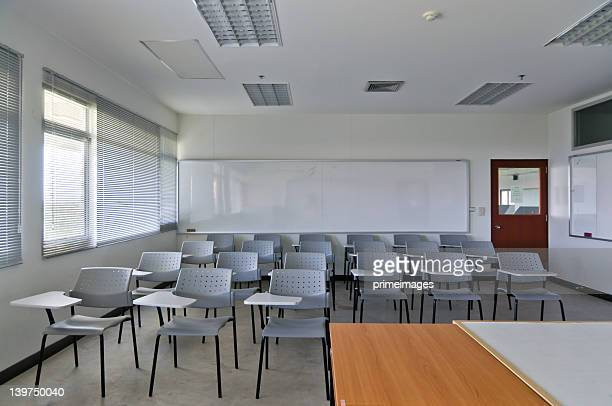 Empty classroom with chairs and white board