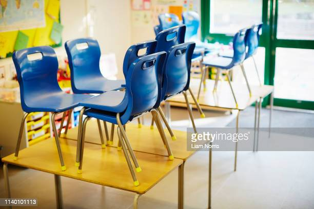 empty classroom with chairs on desk in elementary school - small stock pictures, royalty-free photos & images