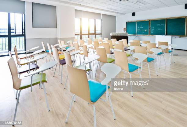 empty classroom with desks and chairs for music lessons - lecture hall stock pictures, royalty-free photos & images