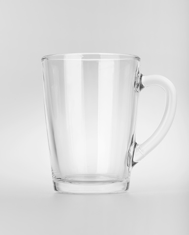 Empty clear glass mug with reflections, isolated on white background - gettyimageskorea