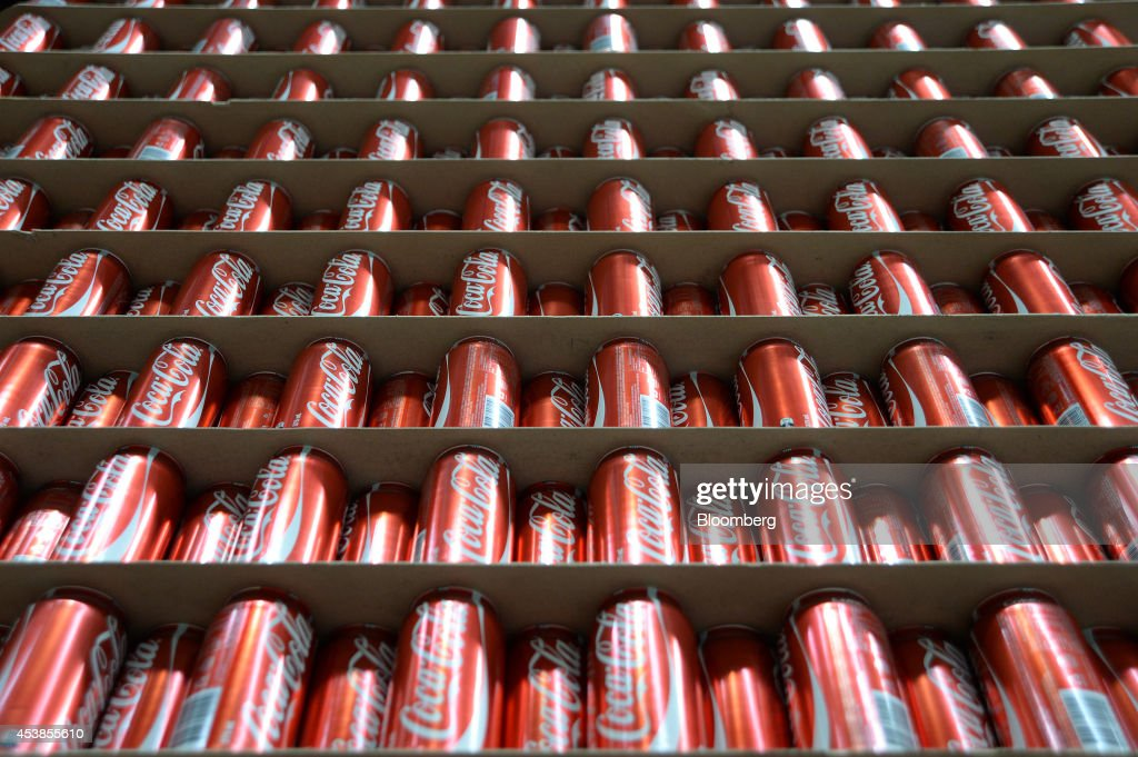 Empty Coca-Cola Classic cans stand ready for filling at a Coca-Cola Amatil Ltd. production facility in Melbourne, Australia, on Tuesday, Aug. 19, 2014. Coca-Cola Amatil flagged a second consecutive drop in full-year earnings amid weak consumer confidence and rising costs in Indonesia. Photographer: Carla Gottgens/Bloomberg via Getty Images