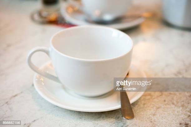 empty coffee cup - saucer stock pictures, royalty-free photos & images