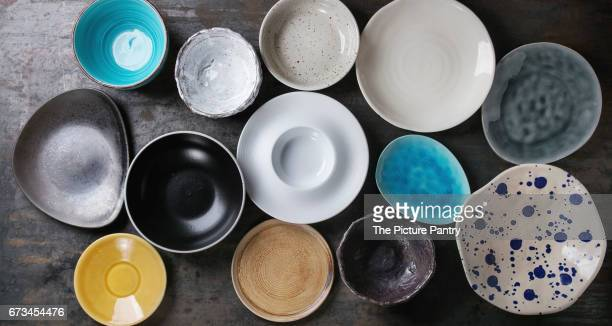 empty colorful plates collection - porcelain stock photos and pictures