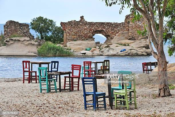 empty colorful wooden chairs on the beach - emreturanphoto stock pictures, royalty-free photos & images