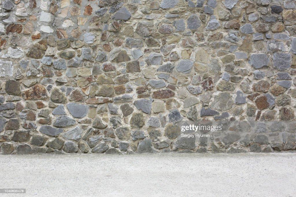Empty concrete floor and stone city wall : Stock Photo