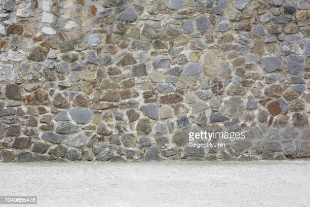 empty concrete floor and stone city wall - stone wall stock pictures, royalty-free photos & images