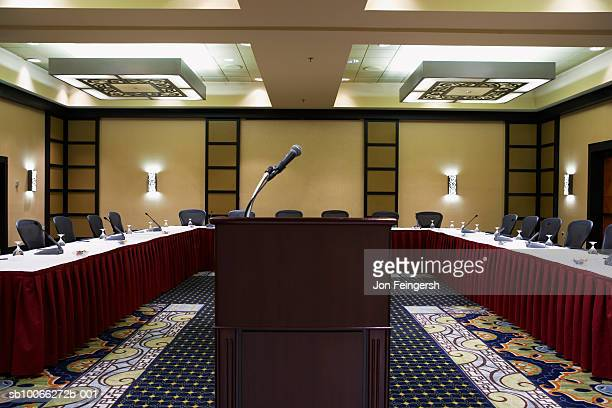Empty conference centre with podium and microphone