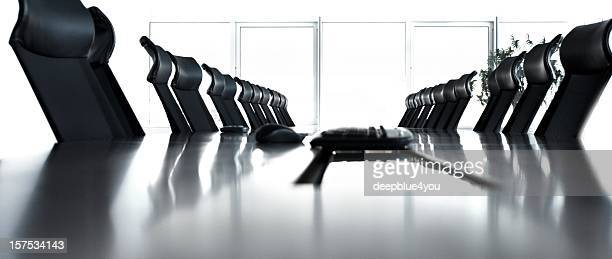 Empty conference room with black chairs in a row