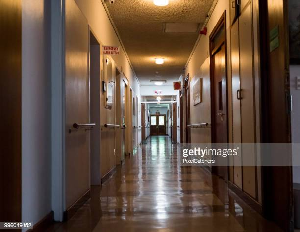 empty corridor in a nursing home - retirement community stock pictures, royalty-free photos & images
