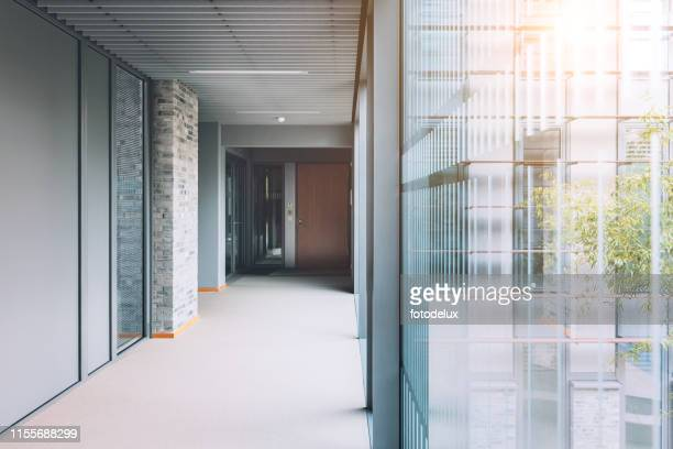 empty corridor in modern office building - corridor stock pictures, royalty-free photos & images
