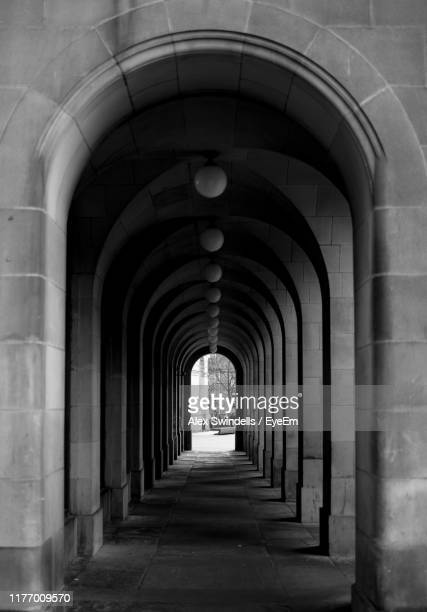 empty corridor of building - arch stock pictures, royalty-free photos & images
