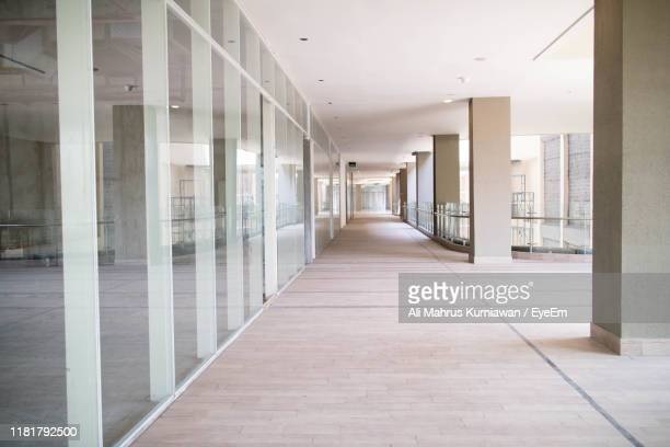 empty corridor of building - corridor stock pictures, royalty-free photos & images