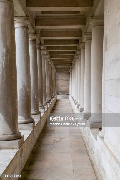 empty corridor with colonnade - beige stock pictures, royalty-free photos & images