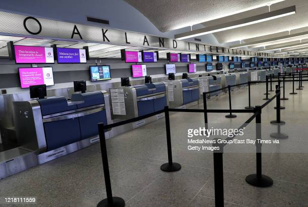 Empty counters are seen at Oakland International Airport's Terminal 1 in Oakland, Calif., on Monday, April 6, 2020. The airport was nearly deserted...