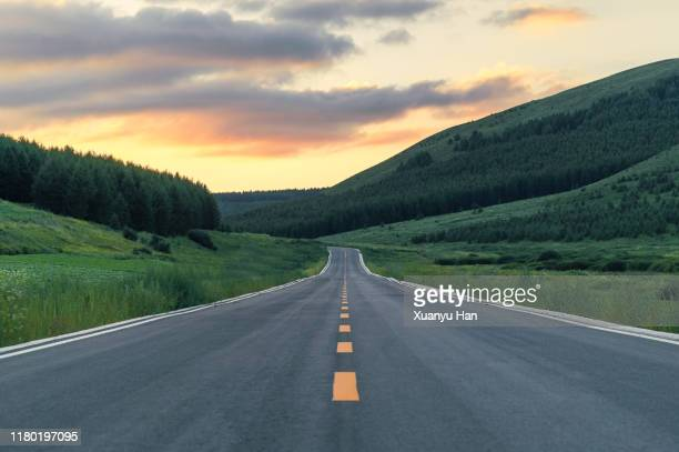 empty country road at dusk - straight stock pictures, royalty-free photos & images
