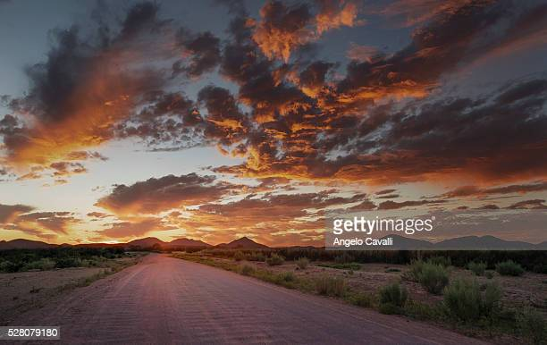 Empty country road at sunset.