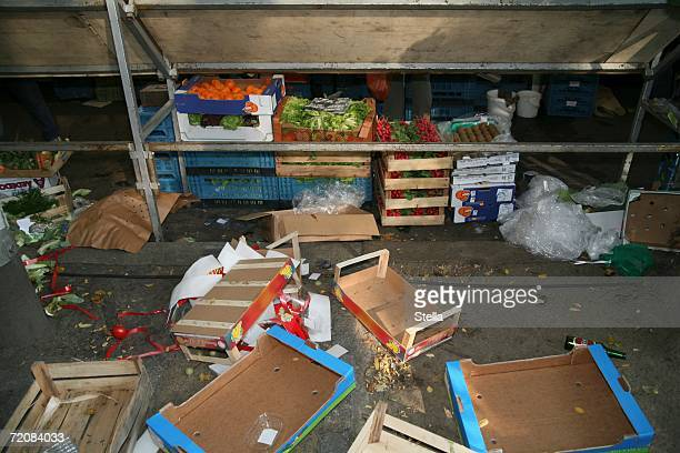Empty crates and fruit cartons behind market stall