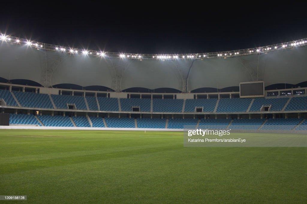 Empty cricket stadium during dusk. : Stock Photo
