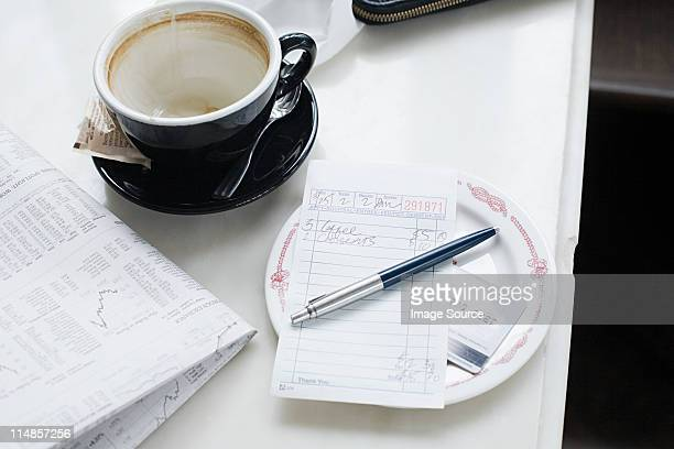 empty cup and check in cafe - empty paper plate stock photos and pictures