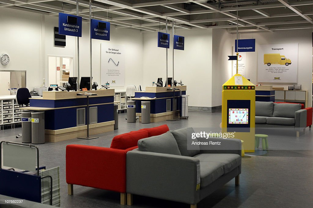Empty Customer Service Desks Are Pictured During A Store Opening At