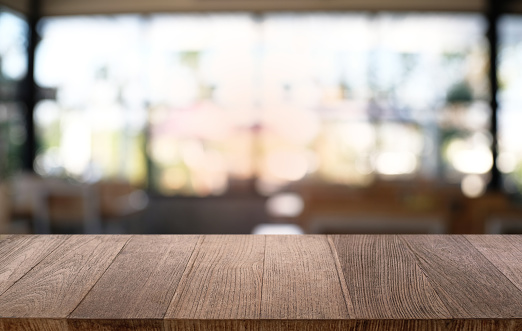 Empty dark wooden table in front of abstract blurred bokeh background of restaurant . can be used for display or montage your products.Mock up for space. 1090727002