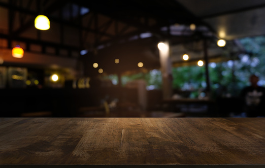 Empty dark wooden table in front of abstract blurred bokeh background of restaurant . can be used for display or montage your products.Mock up for space. 1130714046