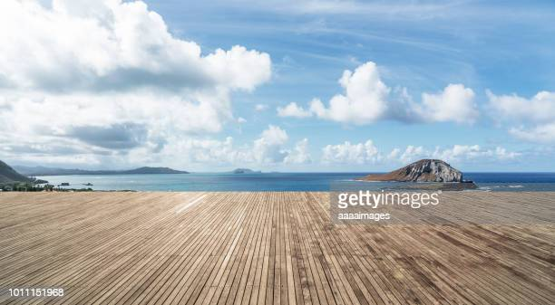 empty deck against sea and sky - water's edge stock pictures, royalty-free photos & images