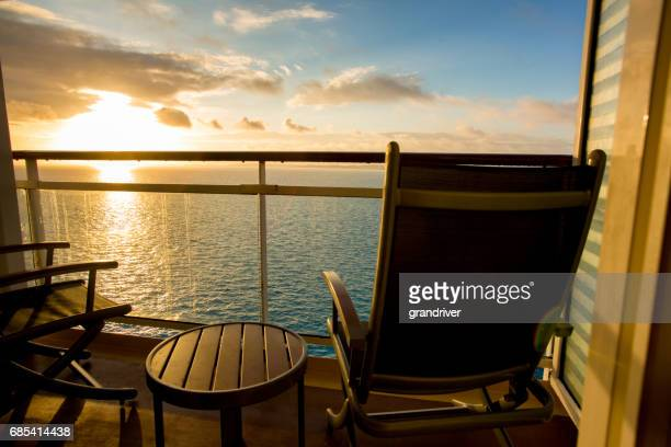 Empty Deck Chair on a Cruise Ship Balcony at Dusk
