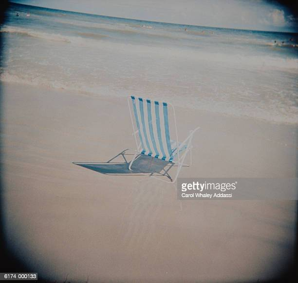 Empty Deck Chair on Beach