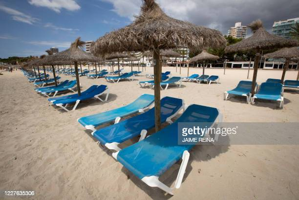 Empty deck chairs are pictured at Magaluf beach, Calvia, in Spain's Balearic island of Majorca on July 16, 2020. - Regional authorities on Spain's...