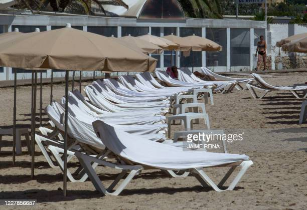 Empty deck chairs are pictured at Talamanca beach in Ibiza, on July 31, 2020. - With Spanish health authorities struggling with a rising number of...