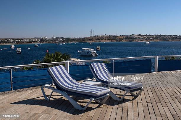 Empty deck chairs are seen on a hotel rooftop overlooking the resort town of Naama Bay on April 1 2016 in Sharm El Sheikh Egypt Prior to the Arab...