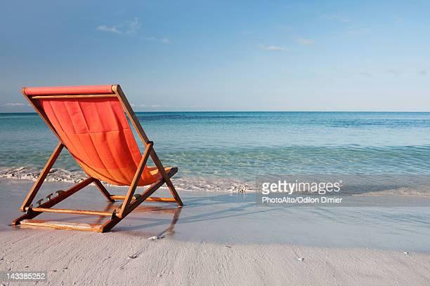 Empty deckchair on beach