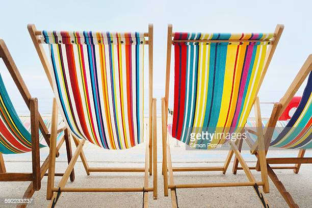 Empty deckchairs in a row