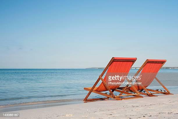 Empty deckchairs on beach