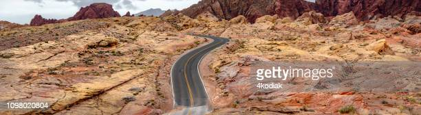 empty desert road on red rock canyon - empty road stock pictures, royalty-free photos & images